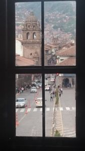 Plaza De Armas through the window of Paddy's Irish Bar.